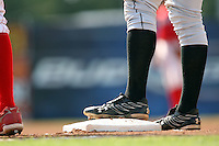 July 14th 2008:  A runner leads off first base wearing Under Armour cleats during a game at Dwyer Stadium in Batavia, NY.  Photo by:  Mike Janes/Four Seam Images