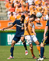 Houston Dynamo midfielder Brad Davis (11) heads the ball away from Los Angeles Galaxy defender Sean Franklin (28). Houston Dynamo tied Los Angeles Galaxy 0-0 at Robertson Stadium in Houston, TX on October 18, 2009.