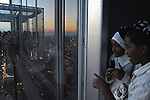 "Visitors are seen on the newly opened glass balconies ""The Ledge"" at the Skydeck at the Sears Tower in Chicago, Illinois on July 6, 2009."