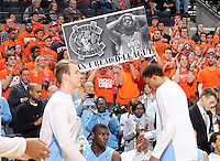 Virginia fans hold up negative signs against North Carolina  during an NCAA basketball game against Virginia Monday Jan. 20, 2014 in Charlottesville, VA. Virginia defeated North Carolina 76-61.