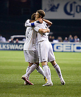 David Beckham (23) helps celebrate the goal of teammate Mike Magee (18) of the LA Galaxy during the game at RFK Stadium.  D.C. United tied the LA Galaxy, 1-1.