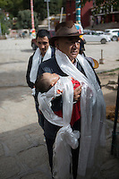 Blind Tibetan Headmaster Nyima Wangdu of the School for the Blind In Tibet and wife Yudon follow relative Jampa Choedon who carries their daughter Tenzin Dichen during a pilgrimage trip to Drepung Monastery in the capital city of Lhasa, September 2016.