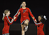 Mary Mileo, center, and fellow Freeport varsity cheerleaders Lizzie Hastings, left, and Angelica Olvio entertain the crowd during halftime of a Nassau County Conference I varsity football game between the Red Devils and Oceanside at Freeport High School on Friday, Sept. 21, 2018.