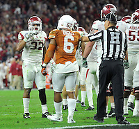 NWA Media/Michael Woods --12/29/2014-- w @NWAMICHAELW...University of Arkansas running back Jonathan Williams waves goodbye to Texas defender Quandre Diggs after scoring a touchdown in the 4th quarter of the Razorbacks  31-7 win over the University of Texas at the Texas Bowl Monday night at  NRG Stadium in Houston.