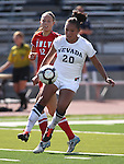 Nevada's Chrisalyn Fonte fights for the ball with UNLV's Denali Murnan during a soccer game in Reno, Nev., on Sunday, Sept. 3, 2011..Photo by Cathleen Allison