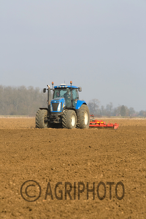New Holland T8050 power harrowing land after potatoes ready for spring drilling.Picture Tim Scrivener date taken 4th March 2013.mobile 07850 303986 e-mail tim@agriphoto.com.....covering agriculture in the Uk....