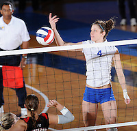 22 November 2008:  New Orleans middle blocker Kaley Hubbard (4) attempts a shot during the WKU 3-0 victory over New Orleans in the championship game of the Sun Belt Conference tournament at U.S. Century Bank Arena in Miami, Florida.