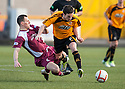 Alloa's Kevin Cawley is challenged by Arbroath's Alex Keddie.