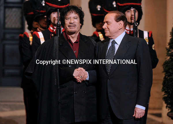 "MUAMMAR AL GADDAFI AND SILVIO BERLUSCONI.Palazzo Chigi, Rome_17/11/2009.Mandatory Credit Photo: ©NEWSPIX INTERNATIONAL..**ALL FEES PAYABLE TO: ""NEWSPIX INTERNATIONAL""**..IMMEDIATE CONFIRMATION OF USAGE REQUIRED:.Newspix International, 31 Chinnery Hill, Bishop's Stortford, ENGLAND CM23 3PS.Tel:+441279 324672  ; Fax: +441279656877.Mobile:  07775681153.e-mail: info@newspixinternational.co.uk"