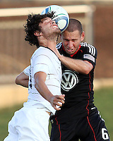 Kurt Morsink #6 of D.C. United goes for a header against Kai Kasiguran #17 of the Harrisburg City Islanders during a US Open Cup match at the Maryland Soccerplex on July 21 2010, in Boyds, Maryland. United won 2-0.