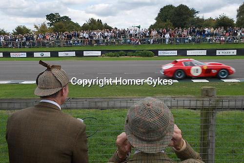 Goodwood Festival of Speed. Goodwood Sussex. Men in their hunting tweeds, they hav forgotten to bring ear defenders.