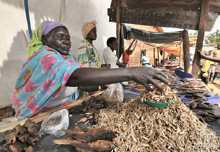 Christine Ataya sells dried shrimp in the market in Yei, Southern Sudan, supported by a microfinance program run by the United Methodist Women in Yei. NOTE: In July 2011, Southern Sudan became the independent country of South Sudan