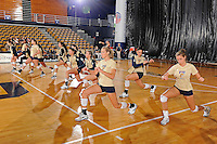 11 September 2011:  FIU's team stretches prior to the match.  The FIU Golden Panthers defeated the Florida A&M University Rattlers, 3-0 (25-10, 25-23, 26-24), at U.S Century Bank Arena in Miami, Florida.