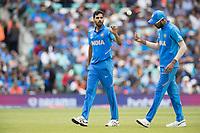 Hardik Pandya (India) tosses the ball to bowler Bhuvneshwar Kumar (India) during India vs Australia, ICC World Cup Cricket at The Oval on 9th June 2019