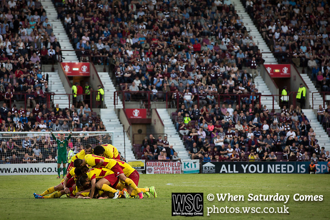 Heart of Midlothian 1 Birkirkara 2, 21/07/2016. Tynecastle Park, UEFA Europa League 2nd qualifying round. Visiting players pile up to celebrate Christian Bubalovic's opening goal at Tynecastle Park, Edinburgh as Heart of Midlothian played Birkirkara of Malta in a UEFA Europa League 2nd qualifying round, second leg. The match ended in victory for the Maltese side by 2-1 and they progressed on aggregate after the first match had ended 0-0. The game was watched by 14301 spectators, including 56 visiting fans of Birkirkara. Photo by Colin McPherson.