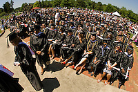 Graduates look on during a graduation ceremony Belmont Abbey College Graduation in Belmont Abbey.