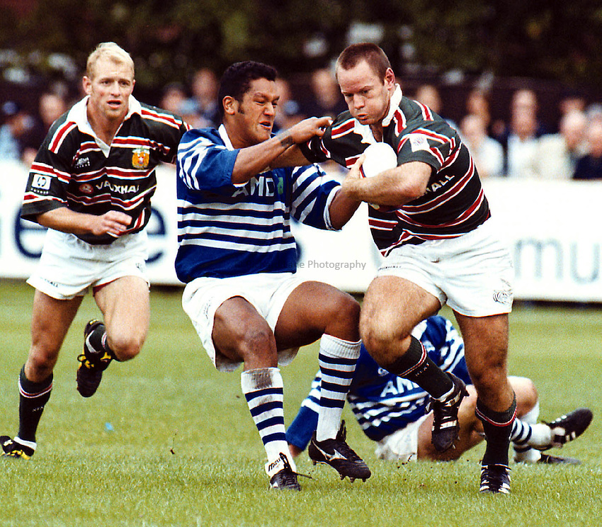 Sale v Leicester_Mike Brett_30900.Sale fly half Niki Little tackles centre Pat Howard.Little dropped the goal which earned Sale a draw
