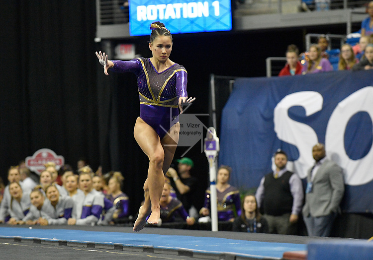 The SEC National Gymnastic Championship was held on Saturday March 24 at Chaifetz Arena on the Saint Louis University campus. Sarah Finnegan of LSU runs towards the vault.<br />Photo by Tim Vizer
