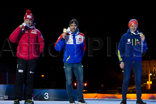 05.03.2016. Oslo Holmenkollen, Oslo, Norway. IBU Biathlon World Cup. Day One.  Ole Einar Bjoerndalen of Norway second place,  Martin Fourcade of France first place and  Sergey Semenov of Ukraine third place winner of  men 10km at the medal ceremony during the IBU World Championships Biathlon in Holmenkollen Oslo, Norway.