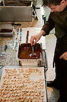 Chocolatier Patrice Arbona makes chocolates in his shop 'Entre Mes Chocolats', Vence, France, 10 February 2011