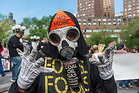 New York, NY 1 May 2017 - May Day protester dressed as the Grim Reaper at a May Day rally for Inernational Workers Day in Union Square Park. ©Stacy Walsh Rosenstock/Alamy Live News