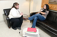 Dr. Christine Calder gives helpful advice to client about pet behavior.