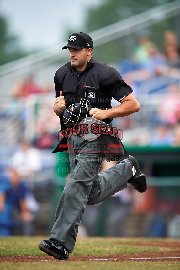 Umpire Thomas Fornarola gets in position to make a call during a game between the Lowell Spinners and Batavia Muckdogs on July 14, 2018 at Dwyer Stadium in Batavia, New York.  Lowell defeated Batavia 8-4.  (Mike Janes/Four Seam Images)