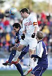 Maryland's Jason Garey (9) outjumps SMU's Mynor Gonzalez (4) and heads the ball. The University of Maryland Terrapins defeated the Southern Methodist University Mustangs 4-1 in a Men's College Cup Semifinal at SAS Stadium in Cary, NC, Friday, December 9, 2005.