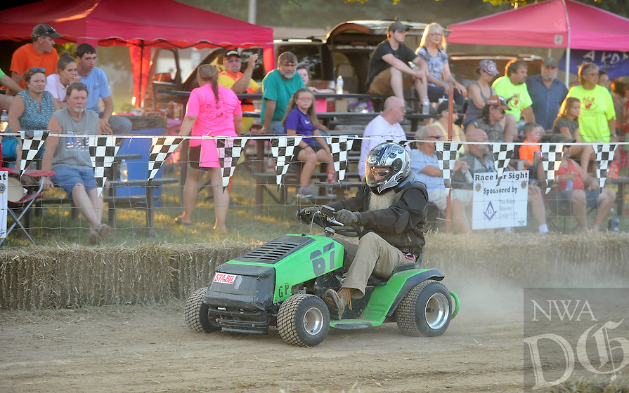 NWA Democrat-Gazette/MICHAEL WOODS &bull; @NWAMICHAELW<br /> Participants and fans enjoy the races Saturday, July 23, 2016 at the Pea Ridge Lions Club's  6th annual Race for Sight Lawnmower Races at the Patterson Farm in Pea Ridge.  The event draws racers from all over the region with the proceeds from the races going to help local health and eye care needs.