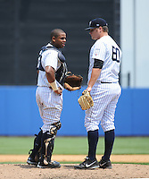 Staten Island Yankees catcher Isaias Tejeda (29) and pitcher Cale Coshow (60) during game against the Mahoning Valley Scrappers at Richmond County Bank Ballpark at St.George on July 22, 2013 in Staten Island, NY.  Mahoning Valley defeated Staten Island 8-2.  Tomasso DeRosa/Four Seam Images