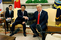 United States President Donald J. Trump shakes hands  with Prime Minister of Japan Shinzo Abe in the Oval Office of the White House on June 7, 2018 in Washington, DC.<br /> <br /> CAP/MPI/RS<br /> &copy;RS/MPI/Capital Pictures