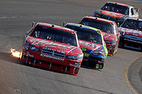 Nov. 9, 2008; Avondale, AZ, USA; NASCAR Sprint Cup Series driver Kasey Kahne (9) leads a pack of drivers during the Checker Auto Parts 500 at Phoenix International Raceway. Mandatory Credit: Mark J. Rebilas-
