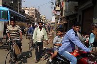 Pedestrians, bicycles and motorbikes mix on the streets of Kolkata.<br /> <br /> To license this image, please contact the National Geographic Creative Collection:<br /> <br /> Image ID: 1925758 <br />  <br /> Email: natgeocreative@ngs.org<br /> <br /> Telephone: 202 857 7537 / Toll Free 800 434 2244<br /> <br /> National Geographic Creative<br /> 1145 17th St NW, Washington DC 20036