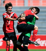 Maxime Crepeau (1) of Canada embraces teammate Samuel Piette (2) as Parker Seymour (6) runs up to celebrate after the quarterfinals of the CONCACAF Men's Under 17 Championship at Catherine Hall Stadium in Montego Bay, Jamaica. Canada defeated Trinidad & Tobago, 2-0.