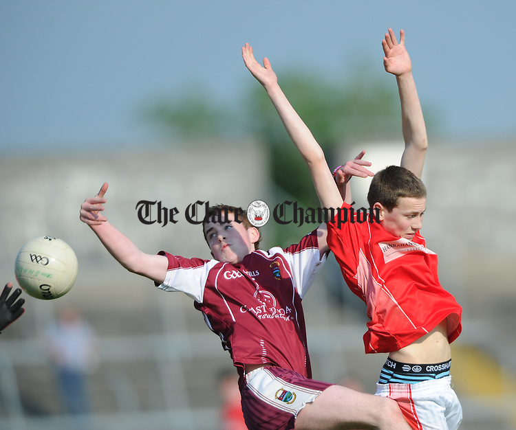 Seamus Collins of Lissycasey in action against XXX of Eire Og during their U-16 Division 1 county final at Cusack Park. Photograph by John Kelly.