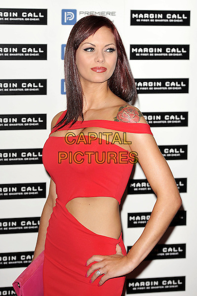 Jessica-Jane Clement .The 'Margin Call' UK film premiere, Vue West End cinema, Leicester Square, London, England..January 9th, 2012.half length dress hand on hip tattoo red cut out away sleeveless .CAP/MAR.© Martin Harris/Capital Pictures.