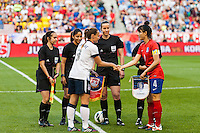 United States (USA) defender Christie Rampone (3) and Korea Republic (KOR) defender Shim Seoyeon (4) shake hands prior to the start of the match. The women's national team of the United States defeated the Korea Republic 5-0 during an international friendly at Red Bull Arena in Harrison, NJ, on June 20, 2013.
