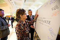 "TALLAHASSEE, FLA. 5/3/13-SESSIONEND050313CH-Hedy Weddington of Auburndale, center, a lobbyist with Florida Strategic Group, signs a giant get well card held by Van Poole, right, for long-time lobbyist and former Sen. Ken Plante during the final day of the legislative session May 3, 2013 at the Capitol in Tallahassee. ""If anybody wanted to know how you define statesman I would say  Ken Plante,"" Weddington said..COLIN HACKLEY PHOTO"