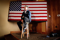 Rick Perry sits on a stool while being introduced at a campaign stop in Carroll, Iowa Monday, January 2, 2012.  (Christopher Gannon/GannonVisuals.com/MCT)