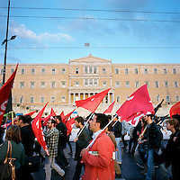 Greek Communist Party supporters demonstrating in front of the parliament building in Syntagma Square during the financial crisis.