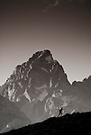 The high peaks of the Tetons loom behind a hiker in Grand Teton National Park, Jackson Hole, Wyoming.