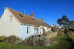 Chalet cottage housing on the coast, Shingle Street, Suffolk, England, UK