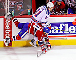 23 January 2010: Montreal Canadiens right wing forward Brian Gionta is upended by New York Rangers right wing forward Enver Lisin in the third period at the Bell Centre in Montreal, Quebec, Canada. The Canadiens shut out the Rangers 6-0. Mandatory Credit: Ed Wolfstein Photo