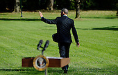 """United States President Obama waves to onlookers after delivering a statement on Ebola from  the South Lawn of the White House in Washington, D.C. on Tuesday, October 28, 2014. In his remarks the President said America """"cannot shy away"""" from leadership.  He then departed for Milwaukee for campaign events, and is scheduled to return tonight.<br /> Credit: Olivier Douliery / Pool via CNP"""