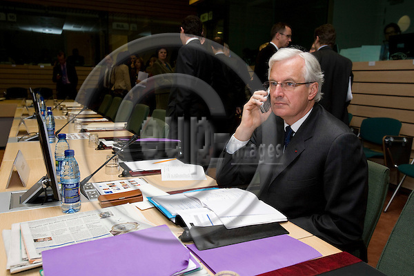 BRUSSELS - BELGIUM - 27 NOVEMBER 2007 -- Michel BARNIER, French Minister of Agriculture, speaking on his GSM phone at the beginning of Agriculture and Fisheries council meeting.  Photo: Erik Luntang/EUP-IMAGES