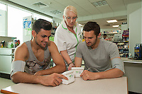 ASDA Old Mill Lane's new pharmacy has opened, two of the first visitors taking advantage of a free blood pressure check were Mansfield Town players Ryan Tafazolli (left) and Andy Owens who are pictured with Pharmacy Dipenser Anita Smithyman.                           .