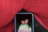 Two young Chinese women perform during a temple fair at Ditan Park to celebrate Chinese New Year in Beijing, China, on February 19, 2010.