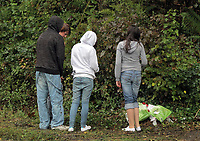 Pictured: Local youngsters leave flowers and tributes near the area where 15 year old Rebecca Aylward was found murdered in Aberkenfig south Wales. Tuesday 26 October 2010<br />