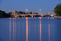 Norwood Bridge and reflections in the Red River at dusk. Winnipeg, Manitoba