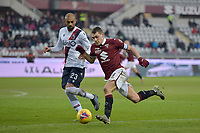 12th January 2020; Olympic Grande Torino Stadium, Turin, Piedmont, Italy; Serie A Football, Torino versus Bologna; Danilo of Bologna FC chases down Andrea Belotti of Torino FC - Editorial Use